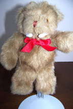 Russ Berrie light brown bear with a red bow - $6.32