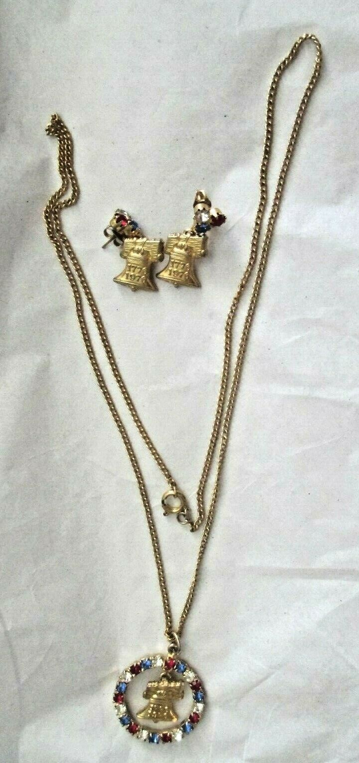 "Primary image for Red White Blue Rhinestone Gold Tone Liberty Bell 24"" Necklace 1"" Earring Set"