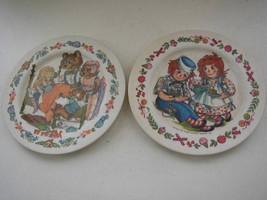 Pair of Bobbs Merril-Oneida De Luxe Fairy Tale Plates- Raggedy Ann & Gol... - $9.45