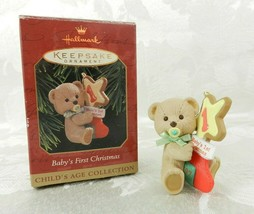 Hallmark Christmas Ornament - Baby's First Christmas 1997 Bear with Stoc... - $14.84