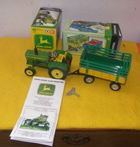 John Deere Wind Up Tin Toy Tractor & Trailer - $140.00