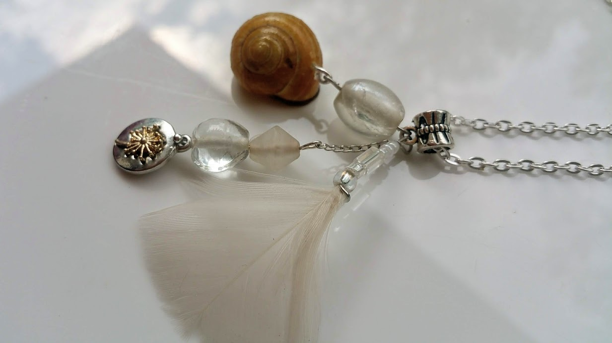 On the Breeze necklace: dandelion charm,  beadwork, chain, & authentic shell