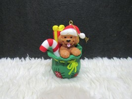 Plastic Puppy With Santa Hat Sitting In Santa's Toy Bag Ornament - $5.95