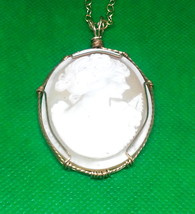 A classic white on beige cameo set in a hand wire sculpted frame of 14k ... - $74.95