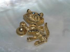 Vintage AVON signed Goldtone Kitty Cat with Blue Rhinestone Eyes & Ringi... - $9.49
