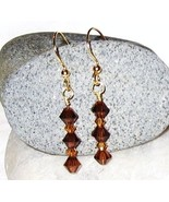 GENUINE Swarovski Crystal Topaz and Smoked Topa... - $12.00