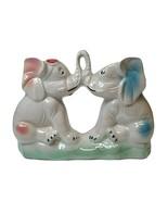Vintage Elephants Kissing Trunks Iridescent finish Made in Brazil Figurine - $11.39