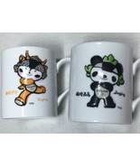 2 Lot Beijing Olympics 2008 Embossed Mugs Mascots Yingying Jingjing GE Sponsor - $15.67