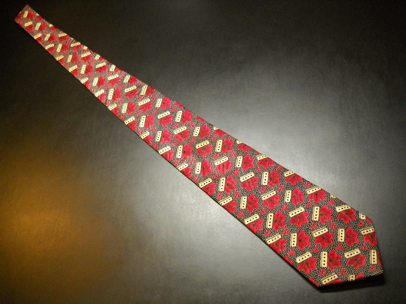 Guy Laroche Paris Neck Tie Repeating Designs in Reds Golds Black Imported Silk