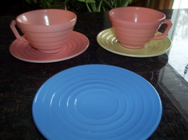 2 Hazel Atlas, Pink Colored Tea Cups, and 3 Saucers, Pink, Yellow and Blue - $9.29