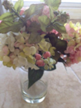 multicolored silk floral arrangement attached within the glass of the vaseo - $29.99