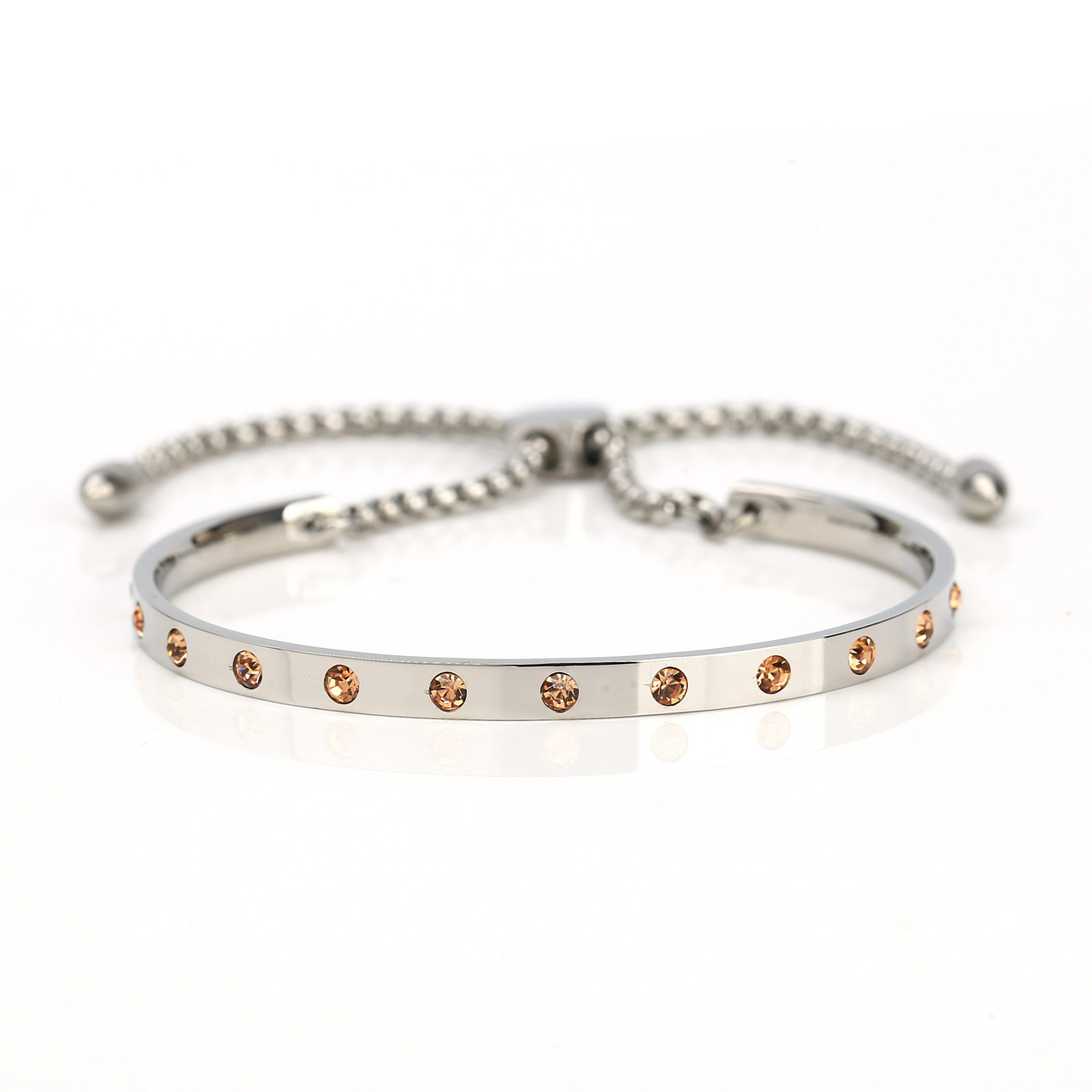 UNITED ELEGANCE Silver Tone Bolo Bracelet, Champagne Swarovski Style Crystals