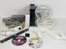 Nintendo Wii  Game Console Bundle (RVL-001) - GameCube Compatible Model - $87.99