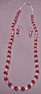 """RED & CRYSTAL BEADS, 28"""" WITH MATCHING EARRINGS  Designed & crafted by the selle"""