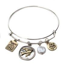 Inspired Silver Gold Sparrow Beaded Pearl Peace Charm Sleek Silver Bangl... - $393,54 MXN