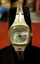 Vintage Elgin ladies quartz wrist watch silver band case face square face - $12.99