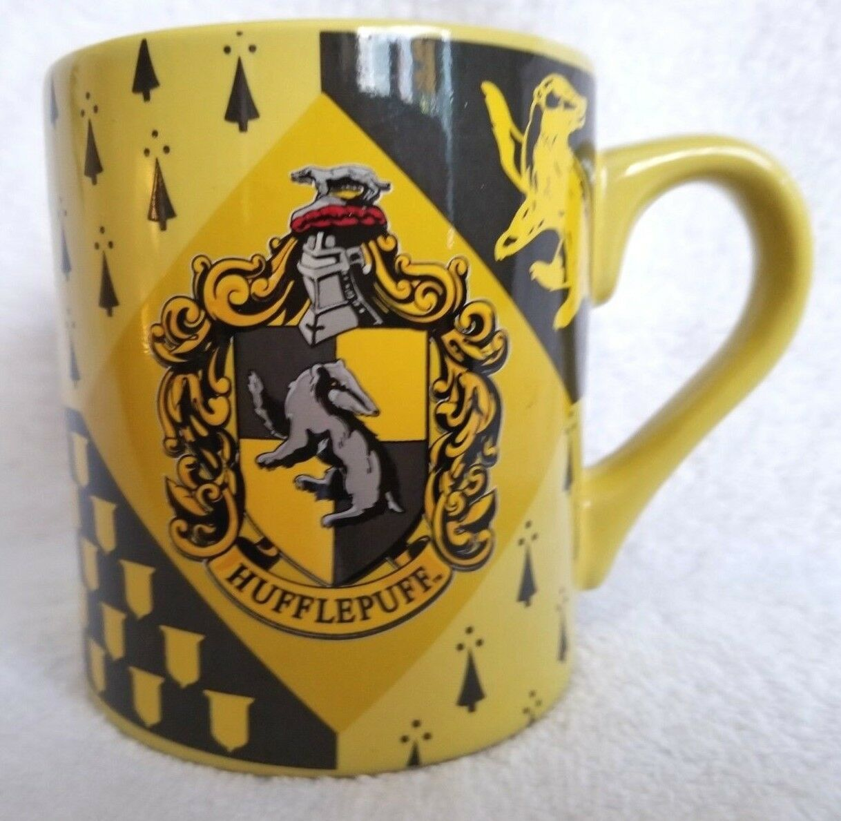 Primary image for Harry Potter Coffee Cup Mug Yellow HUFFLEPUFF Crest Shield Coat of Arms 14 Oz