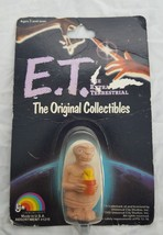 Et The Extra Terrestrial 1982 Universal studios 2 inch figure Holding Plant New - $10.51