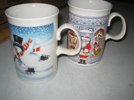 Dunnon CHRISTMAS Mugs Cups Snowman Skating and Santa Mug 2-pc lot - $8.97