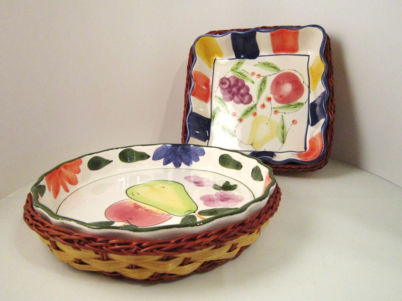 Two Pottery Serving Bowls Wicker Basket Holders, Fruit and Flowers