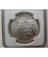 1904 O Morgan Dollar NGC MS64 - $1.469,04 MXN