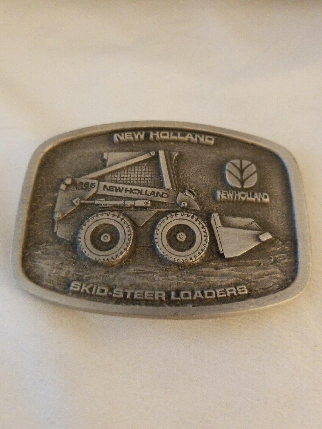 Primary image for New Holland Skid Steer Loaders Pewter Belt Buckle by Spec Cast Made in USA