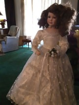 25 inch tall porcelain doll w/beautifull long white gown w/stand - $43.55