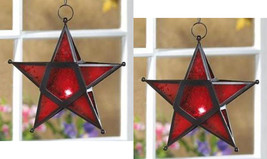 Two (2) wrought iron frame red glass hanging star candleholder lanterns,... - $21.00