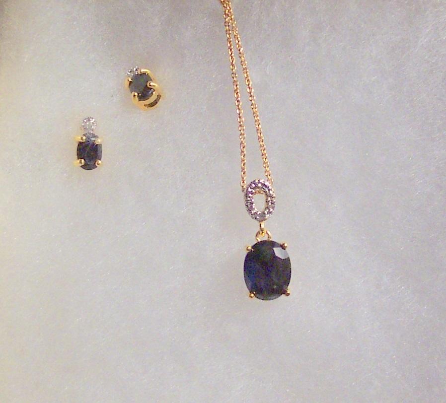 Sapphire set oval cut with o design
