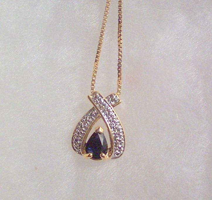Sapphire wishbone pendant