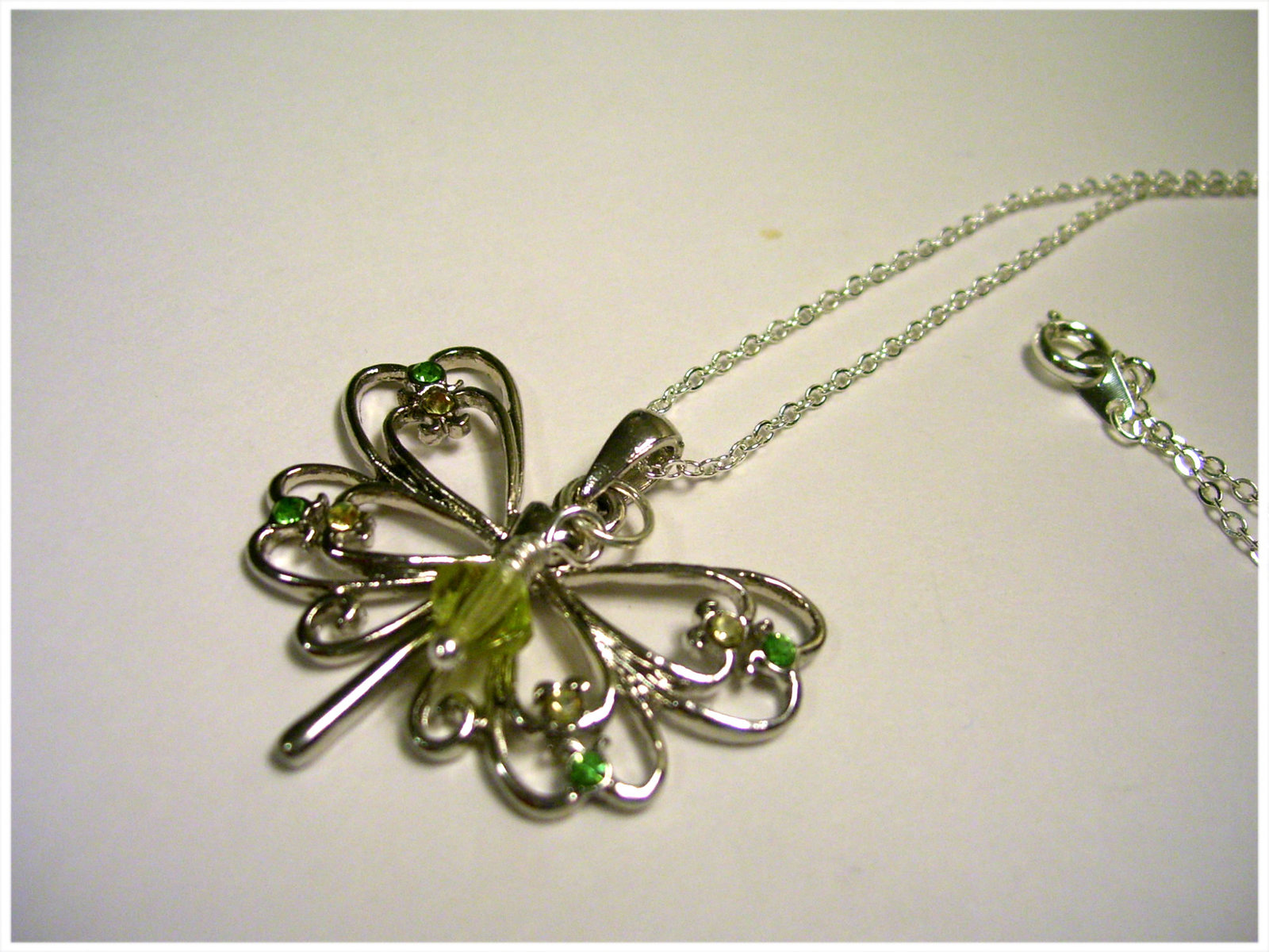 Silver Butterfly charm necklace with yellow and green accents