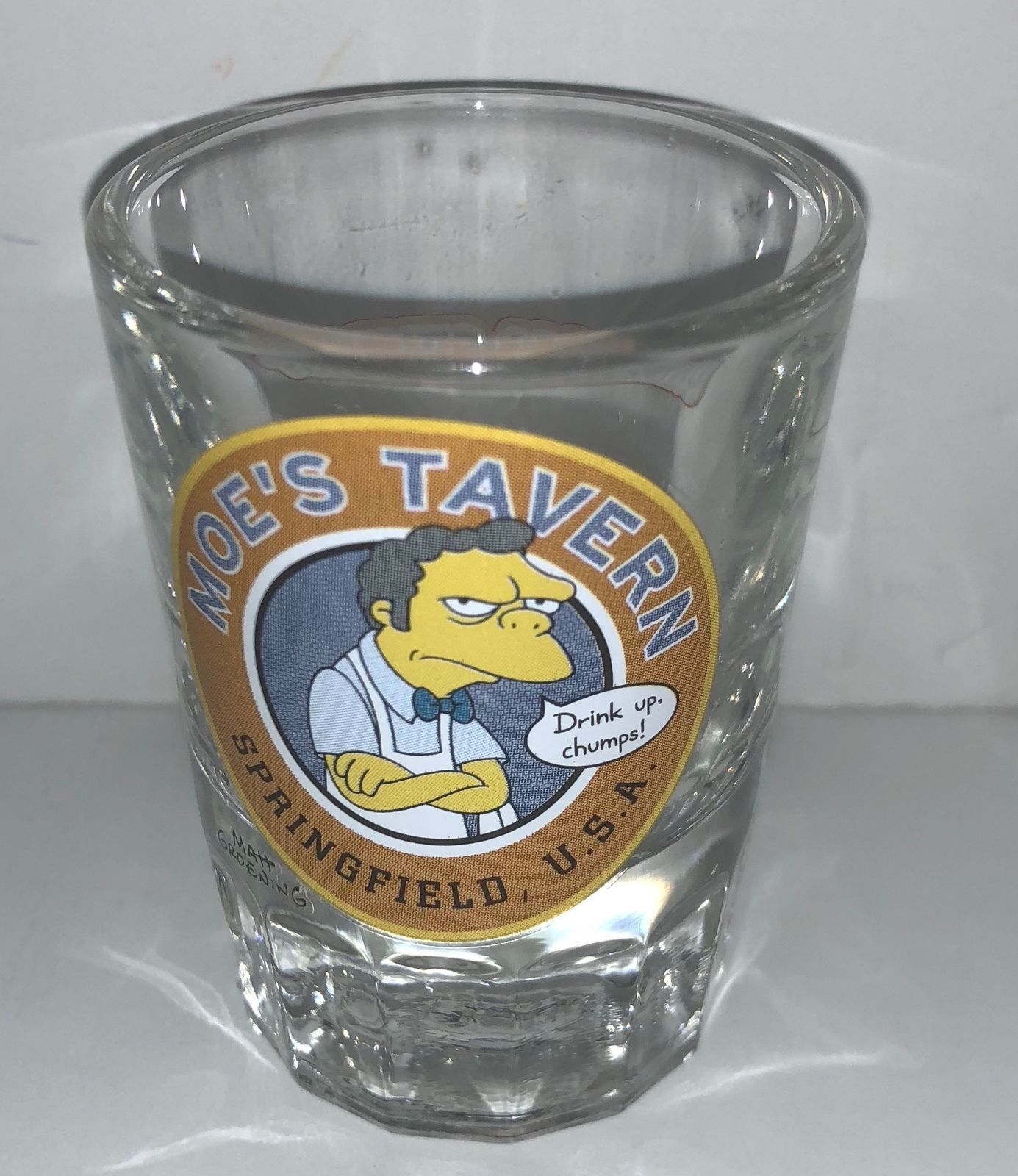 Universal Studios The Simpson Moe's Tavern Drink Up Chumps Shot Glass New