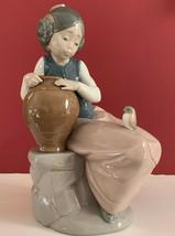 Zaphir Lladro Figurine Girl Sitting on Stone Wall w/ Water Jug & Bird on... - $54.44