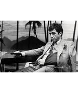 Al Pacino seated as Tony Montana Scarface 18x24 Poster - $23.99