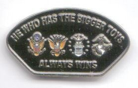12 Pins - HE WHO HAS THE BIGGER TOYS military pin sp472