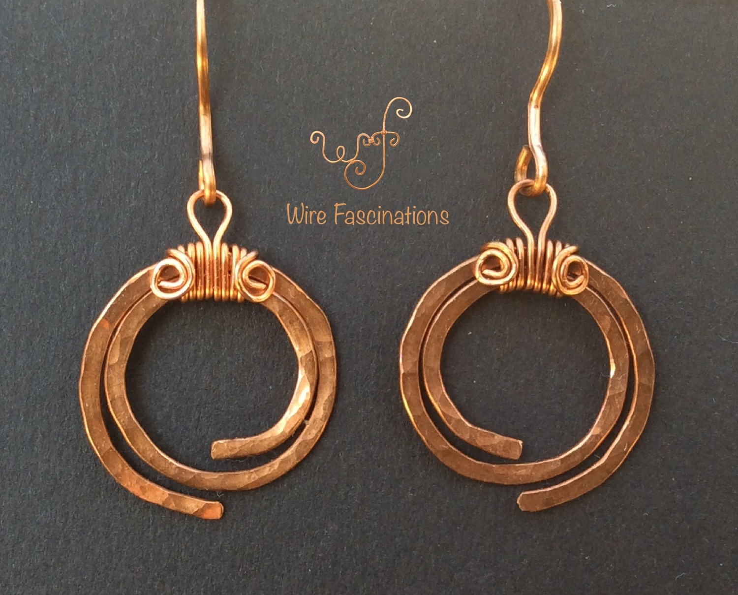 Handmade copper earrings: hammered spirals