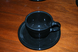 Fiesta black cup and saucer retired color - $6.88