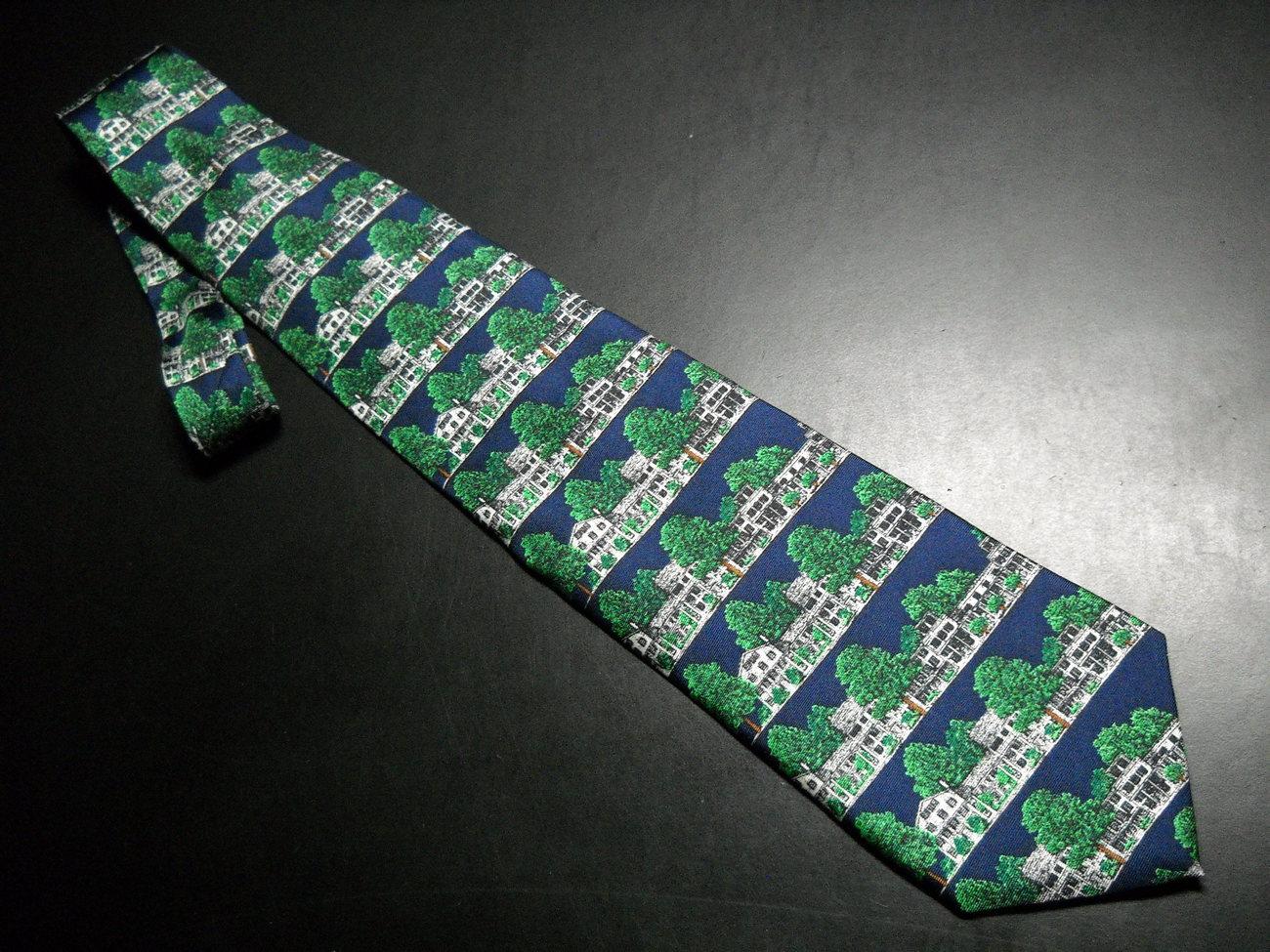 Alynn Neckwear Silk Neck Tie Dark Blue with The Equinox Amoungst Green Foliage