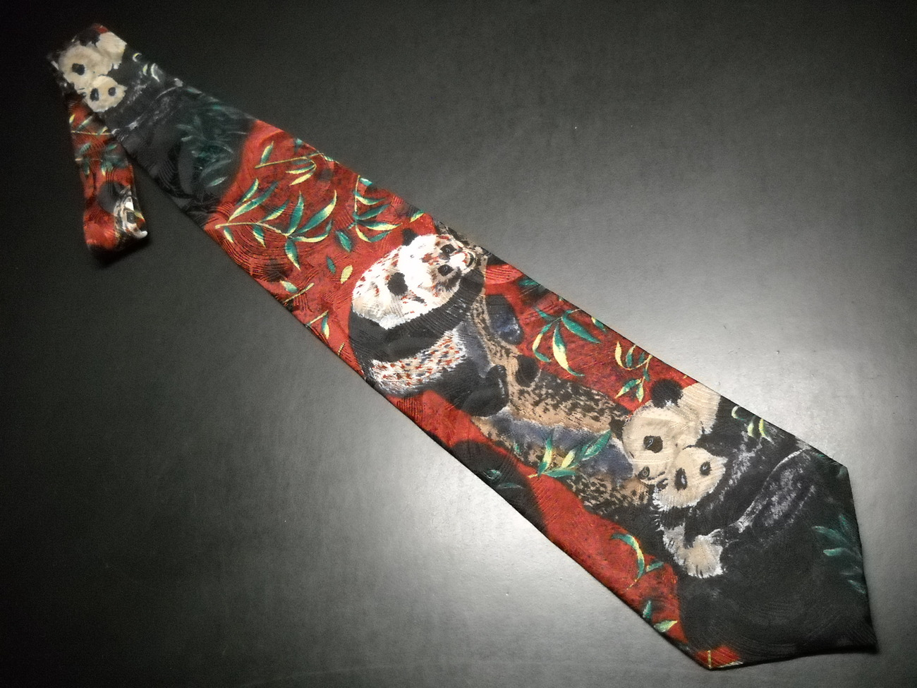 Endangered Species Neck Tie Repeating Pandas on Reds and Greens
