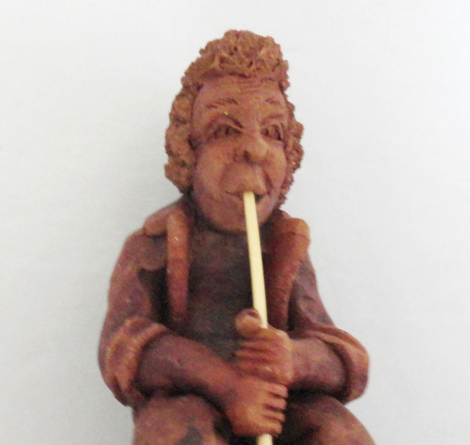 Flute Playing Red Clay Musician Figurine