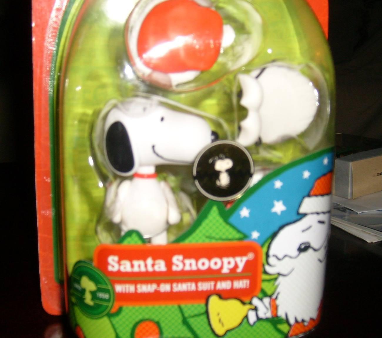 PEANUTS - SANTA SNOOPY CHRISTMAS TOY FIGURE