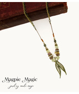 Heritage Drop Necklace: tan, yellow, amber, brass beads; gold vintage le... - $15.00
