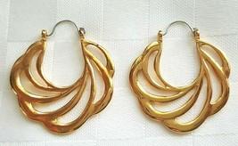 Avon Vintage Earrings Gold Tone 1989 Sweeping Swirl Hoops Pierced - $19.00