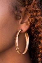 Wind It Up Gold Earring - $5.00