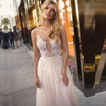 Backless Appliqued with Lace Deep V Neck Beach Wedding Gown Spaghetti Strap image 4