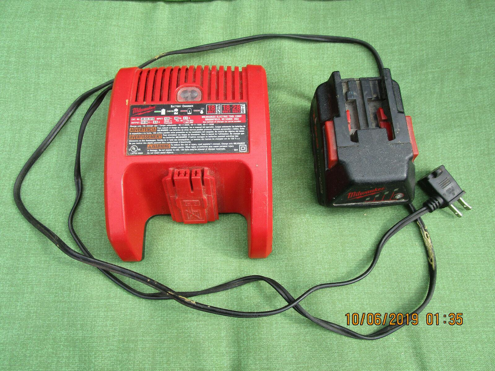Milwaukee 48-59-2818 18-28 Volt Li-on Battery/Battery Charger - $57.99
