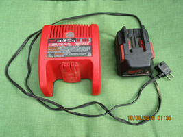 Milwaukee 48-59-2818 18-28 Volt Li-on Battery/Battery Charger - $57.99