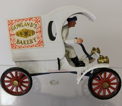 """Gowland's Battery 1904 Oldsmobile model. 3.5"""" and Revell Display case. - $25.00"""