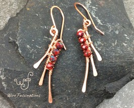 Handmade copper earrings: abstract wire wrapped wings with faceted red b... - $28.00