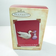 "2004 HALLMARK CHRISTMAS ORNAMENT, ""PRIMERA NAVIDAD DE BEBE"" in box - $7.91"